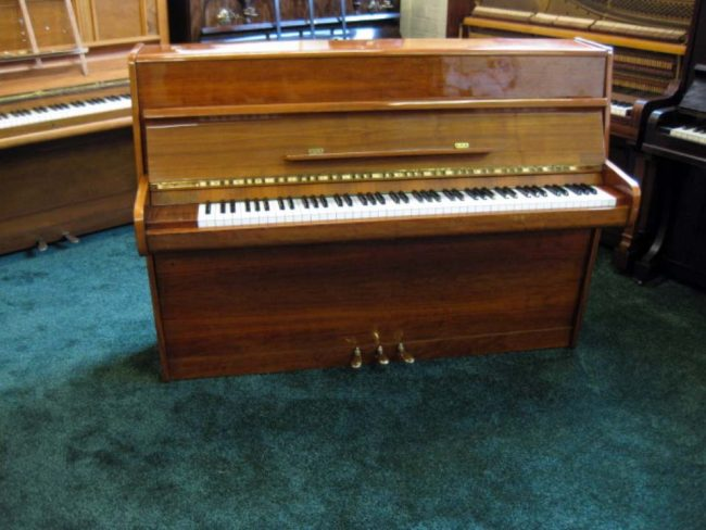 Calisia In Polished Cherry Wood - £1200 - H107 / L148 / D55cm