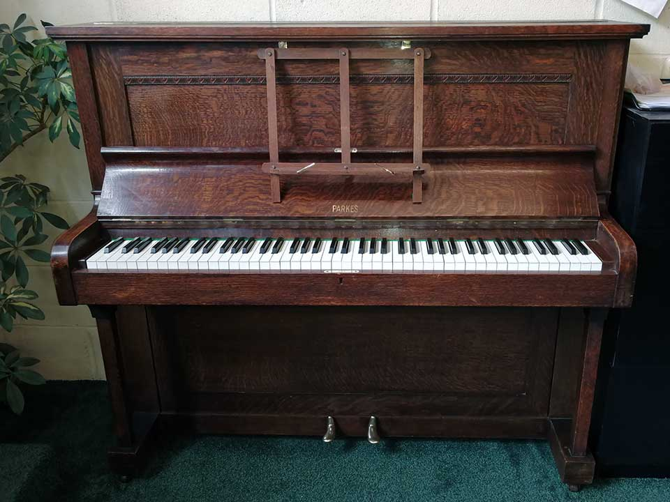 Piano rental W J Parkes & Co upright piano in an oak finish