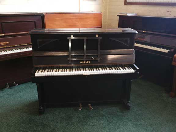 Piano for sale or rent, Warner cottage piano supplied by W H Barnes in Ebony/black